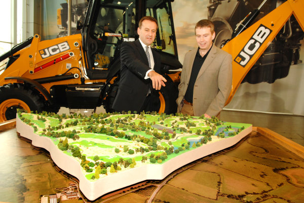 JCB-CEO-Graeme-Macdonald-left-surveys-a-model-of-the-new-JCB-Golf-course-with-course-architect-Robin-Hiseman-of-European-Golf-Design